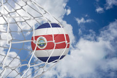 Football in costa rica colours at back of net Royalty Free Stock Images