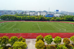 Football court. A big school playground with new plastic track and football court Stock Photography