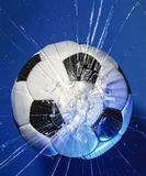 Football crashes into a glass. Window Stock Images