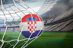 Football in croatia colours at back of net Royalty Free Stock Photo