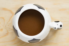Football Cup. Coffee cup designed in football form Royalty Free Stock Photo