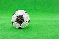 Football cupcake on green grass Stock Photography