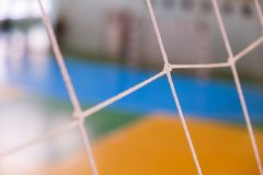 Football defocused gate field, Futsal ball field in the gym indoor, Soccer sport field. Football defocused gate field Small, Futsal ball field in the gym indoor Stock Image