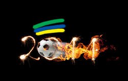 Football design. Soccer ball flying through the number 2014 in the fire Royalty Free Illustration