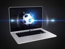 Football destroy laptop Royalty Free Stock Photo