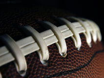 Football Detail. Close-up of an american football showing laces and rubber texture Royalty Free Stock Photos