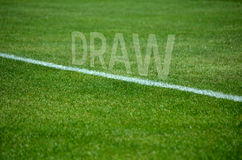Football draw text on grass with white lane Stock Images