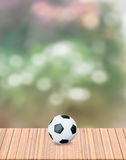 Football on dry wood Stock Photography