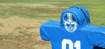 Football Dummy. Blue tackling dummy for football practice on green grass Royalty Free Stock Photo
