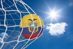 Football in ecuador colours at back of net Royalty Free Stock Photo