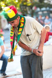 Football elderly fan wearing Portuguese team hat and scarf during the Euro 2016 Final. Elderly Portuguese supporter wearing a national team scarf before the stock images