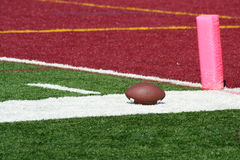 Football end zone with ball Royalty Free Stock Image