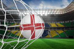 Football in england colours at back of net Royalty Free Stock Photography
