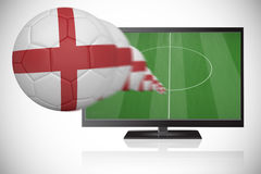Football in england colours flying out of tv Stock Image