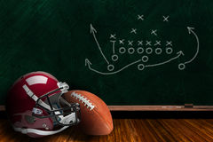 Football Equipment and Chalk Board Play Strategy Background Stock Image
