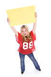 Football: Excited Woman Holding Up Blank Sign Royalty Free Stock Photo
