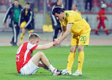 Football fair play. Football players pictured in a fair play gesture at the end of the Romanian League 1 game between Dinamo Bucharest and FC Vaslui held on Stock Photo