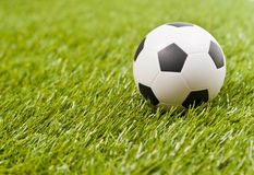 Football on the fake green grass royalty free stock images