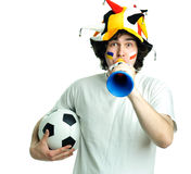 Football fan with ball and trumpet Royalty Free Stock Image