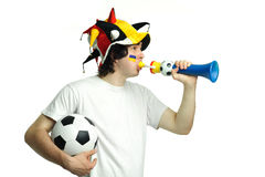 Football fan with ball and trumpet Stock Photo
