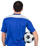 Football fan in blue holding ball Royalty Free Stock Photo