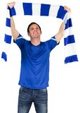 Football fan in blue holding scarf Royalty Free Stock Images