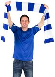 Football fan in blue holding scarf Stock Photos