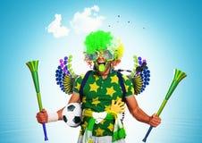 Football fan. Brazil football fan in a green wig and horns Stock Image