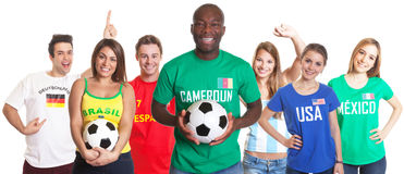 Football fan from Cameroon with ball and other fans Royalty Free Stock Image