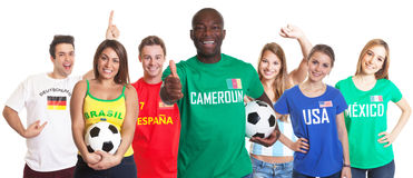 Football fan from Cameroon showing thumb with ball and other fans Stock Images