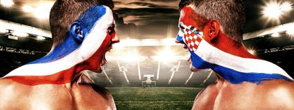 Soccer or football fan athlete with bodyart on face - flags of France vs Croatia. Sport Concept with copyspace. Final. Stock Image