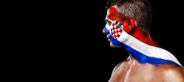 Soccer or football fan with bodyart on face with agression - flag of Croatia. Football of fan are cheering for their team victory royalty free stock photography