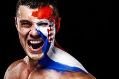 Soccer or football fan with bodyart on face with agression - flag of Croatia. Football of fan are cheering for their team victory royalty free stock photo