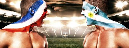 Soccer or football fan with bodyart on face with agression - flag of France vs Argentina. Football of fan are cheering for their team victory stock photos