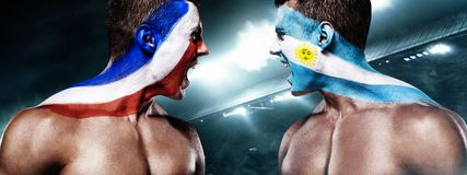 Soccer or football fan with bodyart on face with agression - flag of France vs Argentina. Football of fan are cheering for their team victory royalty free stock photography