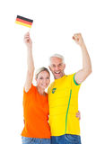 Football fan couple cheering and smiling at camera Stock Image