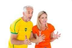 Football fan couple looking nervously ahead Stock Photo