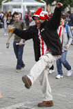 Football fan drinking and dancing Stock Images