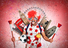 Football fan. English football fan in a red wig and horns Royalty Free Stock Photography