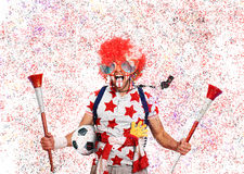 Football fan. English football fan in a red wig and horns Royalty Free Stock Image