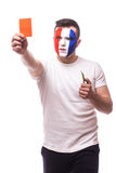 Football fan of France national football team demonstrate red card on camera Stock Images