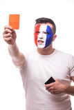 Football fan of France national football team demonstrate red card on camera Royalty Free Stock Photos