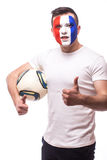Football fan of France national team with ball in arm show okey sign. On white background. European football fans concept Stock Photo