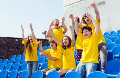 Football fan with his hands in the air Stock Photo