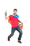 Football fan holding a beer and football. Football fan covered with dutch flag and holding a beer bottle and football cheering  on white background Royalty Free Stock Photos