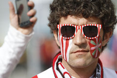 Football fan with painted face. Athletic Bilbao's fan during a visit to Bucharest for the Europa League Final against Atletico Madrid Stock Photo