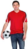 Football fan in red holding ball Royalty Free Stock Image