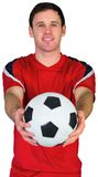 Football fan in red holding ball Stock Photo