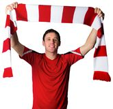 Football fan in red holding scarf Stock Images