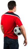 Football fan in red jersey holding ball Royalty Free Stock Photography